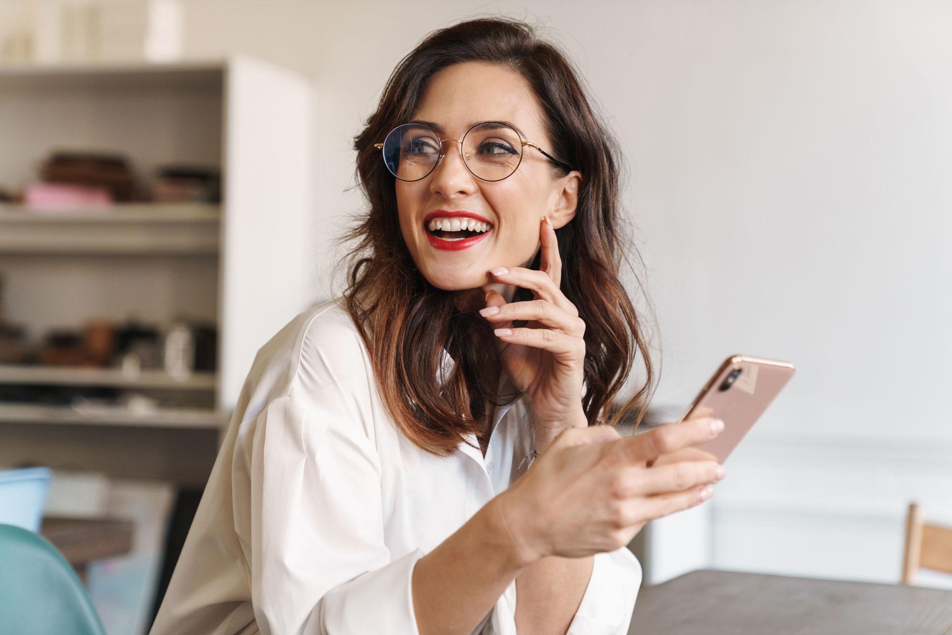 smiling-young-beautiful-woman-using-mobile-phone-XB8WMJW.jpg